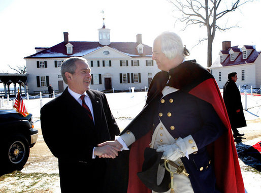 President George W. Bush shakes hands with General George Washington, played by actor Dean Malissa, following President Bush's address at the Mount Vernon Estate, Monday, Feb. 19, 2007 in Mount Vernon, Va., honoring Washington's 275th birthday. White House photo by Eric Draper