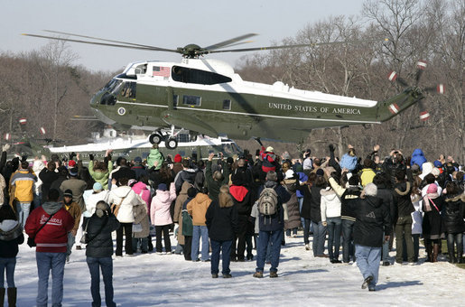 A crowd waves at the lift-off of Marine One carrying President George W. Bush and Mrs. Laura Bush, following their visit to the Mount Vernon Estate of President George Washington, Monday Feb. 19, 2007 in Mount Vernon, Va., in honor of President Washington's 275th birthday. White House photo by Eric Draper