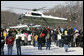 A crowd waves at the lift-off of Marine One carrying President George W. Bush and Mrs. Laura Bush, following their visit to the Mount Vernon Estate of President George Washington, Monday, Feb. 19, 2007 in Mount Vernon, Va., in honor of President Washington's 275th birthday. White House photo by Eric Draper