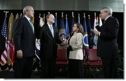 "President George W. Bush stands with Director of National Intelligence J. Michael ""Mike"" McConnell during his ceremonial swearing-in Tuesday, Feb. 20, 2007 at Bolling Air Force Base in Washington, D.C., taking his oath from White House Chief of Staff Josh Bolten , as McConnell's wife, Terry, holds the Bible.  White House photo by Paul Morse"