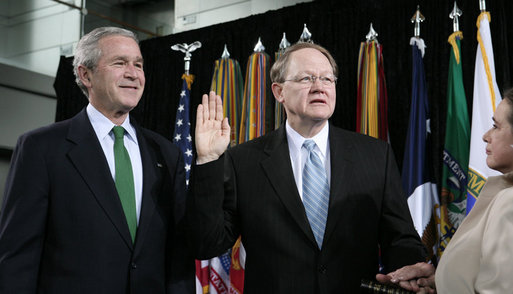 "President George W. Bush attends the ceremonial swearing-in of Director of National Intelligence J. Michael ""Mike"" McConnell, Tuesday, Feb. 20, 2007 at Bolling Air Force Base in Washington, D.C., taking his oath of office as McConnell's wife, Terry, holds the Bible. White House photo by Paul Morse"