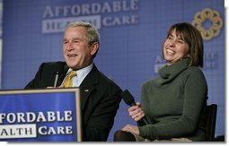 President George W. Bush and panelist Amy Childers react to an audience members question during a forum discussion on health care initiatives Wednesday, Feb. 21, 2007, at the Chattanooga Convention Center in Chattanooga, Tenn. White House photo by Paul Morse