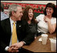 President George W. Bush visits with patrons of Porkers Bar-B-Que restaurant Wednesday, Feb. 21, 2007 in Chattanooga, Tenn., where President Bush stopped by for lunch after attending a forum on health care initiatives at the Chattanooga Convention Center. White House photo by Paul Morse