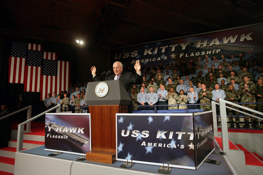 Vice President Dick Cheney waves in response to a welcome Wednesday, Feb. 21, 2007, from troops aboard the USS Kitty Hawk at Yokosuka Naval Base in Japan. White House photo by David Bohrer