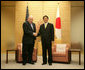 Vice President Dick Cheney stands with Prime Minister of Japan Shinzo Abe before a meeting Wednesday, Feb. 21, 2007, at the Kantei, the official residence of the Prime Minister, in Tokyo. White House photo by David Bohrer