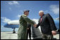 Vice President Dick Cheney is greeted by Brigadier General Doug Owens, Commander, 36th Wing, Thursday, Feb. 22, 2007, upon arrival to Andersen Air Force Base, Guam, for a rally with U.S. troops. White House photo by David Bohrer