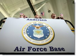 U.S. troops at Andersen Air Force Base, Guam listen from atop a hydraulic lift as Vice President Dick Cheney delivers remarks during a rally, Thursday, Feb. 22, 2007. White House photo by David Bohrer