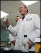 President George W. Bush holds a jar of spruce wood chips during a tour of the labs at Novozymes North America, Inc., Thursday, Feb. 22, 2007 in Franklinton, N.C., during a demonstration on how cellulosic ethanol can be produced from bio mass materials. White House photo by Paul Morse