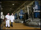 President George W. Bush is escorted on a tour of the fermentation room by David Pace at Novozymes North America, Inc., Thursday, Feb. 22, 2007 in Franklinton, N.C., where cellulosic ethanol is being produced from bio mass materials. White House photo by Paul Morse