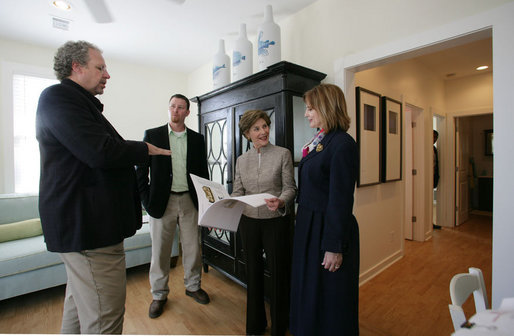 Mrs. Laura Bush talks with Mayor Connie Moran, architect Bruce Tolar, left, and project manager Micah Lewis, center, during a tour of Katrina Cottages, Thursday, Feb. 22, 2007 in Ocean Springs, Miss., the quaint, colorful and quickly built cottages for post-Katrina living. White House photo by Shealah Craighead