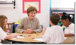 Mrs. Laura Bush participates in a discussion with children in a Boys & Girls Club program Thursday, Feb. 22, 2007 at the D'Iberville Elementary School in D'Iberville, Miss. White House photo by Shealah Craighead