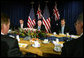 Vice President Dick Cheney is flanked by Tony Abbott, left, Australian Minister for Health and Ageing, and Robert McClelland, Shadow Minister for Foreign Affairs, during a breakfast meeting Friday, Feb. 23, 2007, at the Shangri-La Hotel in Sydney. White House photo by David Bohrer