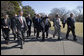 "President George W. Bush walks with transportation fuel experts and researchers back to the Oval Office after a demonstration of alternative fuel automobiles on the South Lawn of the White House Friday, Feb. 23, 2007. ""Now, it's going to require continued federal research dollars, and I call upon the Congress to fully fund my request for alternative sources of energy,"" said President Bush. White House photo by Eric Draper"