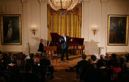 President George W. Bush and Mrs. Laura Bush listen to tenor Ronan Tynan performing in the East Room of the White House Sunday evening, Feb. 25, 2007, during the State Dinner in honor of the Nation's Governors. White House photo by Shealah Craighead
