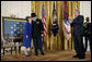 President George W, Bush applauds as Medal of Honor recipient U.S. Army Major Bruce P. Crandall kisses his wife, Arlene, in the East Room of the White House, Monday, Feb. 26, 2007. Crandall was awarded the Medal of Honor for his extraordinary heroism as a 1st Cavalry helicopter flight commander in the Republic of Vietnam in November 1965. White House photo by Eric Draper