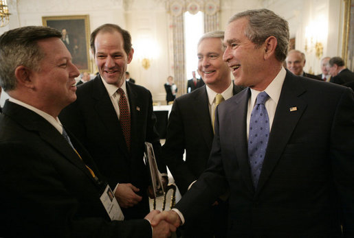 President George W. Bush shakes hands with Nebraska Governor Dave Heineman, left, joined by New York Governor Eliot Spitzer, center and Gov. Mike Easley of North Carolina, following a meeting with the National Governors Association in the State Dining Room of the White House, Monday, Feb. 26, 2007. White House photo by Eric Draper