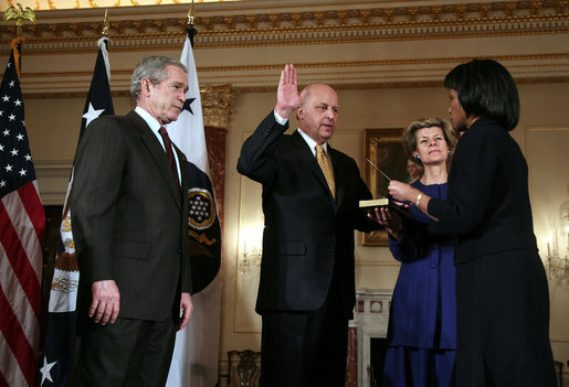 President George W. Bush looks on as Secretary of State Condoleezza Rice administers the oath of office to Deputy Secretary of State John Negroponte Tuesday, Feb. 27, 2007, in the Benjamin Franklin Room at the U.S. Department of State. Holding the Bible for the ceremonial swearing-in is Dr. Diana Negroponte, wife of Secretary Negroponte. White House photo by Paul Morse