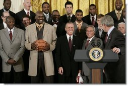 "President George W. Bush draws a laugh from the Miami Heat as the 2006 NBA champs visited the White House Tuesday, Feb. 27, 2007. ""This is a championship team on the court, and this is a championship team off the court,"" said the President. ""And it is my high honor to welcome them to the White House as NBA champs.""  White House photo by Eric Draper"