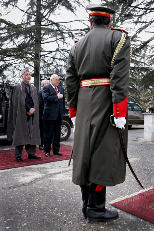 Vice President Dick Cheney stands with Afghan President Hamid Karzai, Tuesday, Feb. 27, 2007 during an arrival ceremony at the presidential palace in Kabul. The Vice President made an unannounced visit to Afghanistan to discuss regional issues and the global war on terror. White House photo by David Bohrer