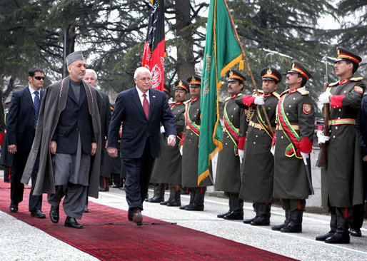 Vice President Dick Cheney and Afghan President Hamid Karzai review an honor guard, Tuesday, Feb. 27, 2007 during the Vice President's arrival to the presidential palace in Kabul. White House photo by David Bohrer