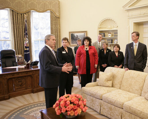 President George W. Bush offers a tour of the Oval Office to the leaders of military service organizations Wednesday, Feb. 28, 2007, following a meeting with the group to thank them for their dedication and commitment in support of America's military and their families at home. White House photo by Eric Draper