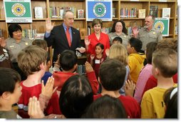 Mrs. Laura Bush and Interior Secretary Dirk Kempthorne swear in new Junior Rangers, students at Balboa Magnet Elementary School Wednesday, Feb. 28, 2007, in Northridge, Calif. The National Park Service Junior Ranger program provides activities in parks and partnering schools to teach young people about America's National Parks. White House photo by Shealah Craighead