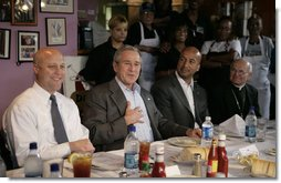 President George W. Bush is joined by New Orleans Mayor Ray Nagin, Louisiana Lt. Gov. Mitch Landrieu, left, and New Orleans Archbishop Alfred Hughes, right, Thursday, March 1, 2007 in New Orleans, during a luncheon with elected officials and community leaders on the recovery progress of their Gulf Coast region. White House photo by Eric Draper