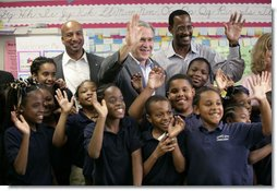 "President George W. Bush with New Orleans Mayor Ray Nagin, left, and Dr. Anthony ""Tony"" Recasner, principal and director of the Samuel J. Green charter school, pose with third grade students for a photo Thursday, March 1, 2007, during President Bush's visit to the Gulf Coast region to see the continued recovery progress of communities devastated by Hurricane Katrina. White House photo by Eric Draper"