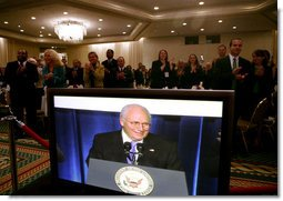 Vice President Dick Cheney, seen on a television monitor, receives a welcome Thursday, March 1, 2007, at the 34th Annual Conservative Political Action Conference in Washington, D.C.  White House photo by David Bohrer