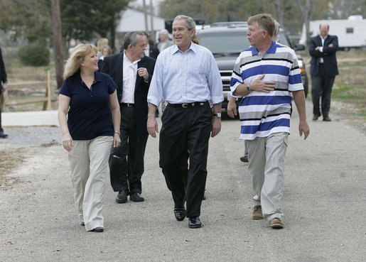 President George W. Bush walks with Cheryl and Ernie Woodard through their Long Beach, Miss., neighborhood Thursday, March 1, 2007, during the President's tour of the neighborhood where some homes, including the Woodward's, damaged by Hurricane Katrina have been rebuilt with Gulf Coast grant money. White House photo by Eric Draper