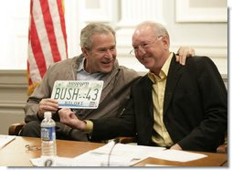 President George W. Bush is presented with a license plate with his name and the number 43 from Biloxi, Miss., Mayor A. J. Holloway, during a meeting Thursday, March 1, 2007 in Biloxi, on the recovery and reconstruction efforts underway in the region devastated by Hurricane Katrina.  White House photo by Eric Draper