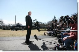 President George W. Bush addresses members of the White House media on the South Lawn of the White House Friday, March 2, 2007, to announce he will travel Saturday to the storm ravaged areas of Georgia and Alabama.  White House photo by Paul Morse