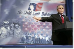 President George W. Bush gestures as he addresses his remarks to students, faculty and guests at the Silver Street Elementary School in New Albany, Ind., Friday, March 2, 2007, urging Congress to reauthorize the No Child Left Behind law.  White House photo by Eric Draper
