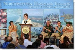 Mrs. Laura Bush is applauded by Hawaiian Gov. Linda Lingle, left, at the Northwest Hawaiian Islands Marine National Monument Naming Ceremony, Friday, March 2, 2007 in Honolulu, where Laura Bush unveiled the new Hawaiian name as the Papahanaumokuakea Marine National Monument. The Northwestern Monument represents the largest single conservation area in our nation's history and the largest protected marine area in the world. White House photo by Shealah Craighead