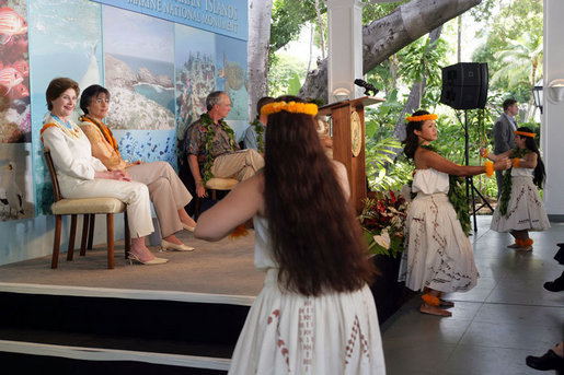 Mrs. Laura Bush and Hawaiian Gov. Linda Lingle watch traditional Hawaiian dancers at the Northwest Hawaiian Islands Marine National Monument Naming Ceremony, Friday, March 2, 2007 in Honolulu, where Laura Bush unveiled the new Hawaiian name as Papahanaumokuakea Marine National Monument. The name for the recently established marine sanctuary was developed by state and federal officials working with native Hawaiian leaders. White House photo by Shealah Craighead