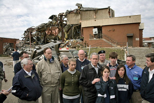 "President George W. Bush talks with the media after walking through the tornado damage at Enterprise High School in Enterprise, Ala., Saturday, March 3, 2007. ""And today I have walked through devastation that's hard to describe,"" said the President. ""Our thoughts, of course, go out to the students who perished. We thank God for the hundreds who lived."" White House photo by Paul Morse"