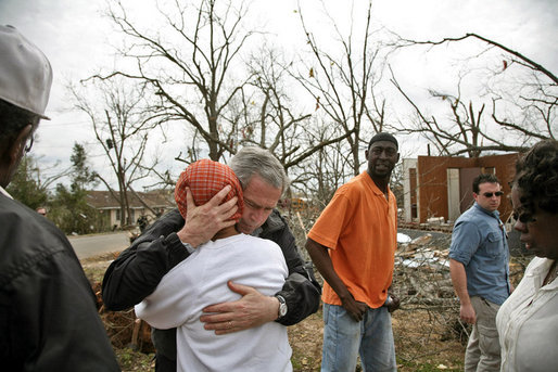 "President George W. Bush comforts residents whose neighborhood was hit by a tornado in Americus, Ga., Saturday, March 3, 2007. ""You can never heal a heart, but you can provide comfort, knowing that the federal government will provide help for those whose houses were destroyed, or automobiles were destroyed,"" said President Bush during his trip to Enterprise, Ala., and Americus, Ga. White House photo by Paul Morse"