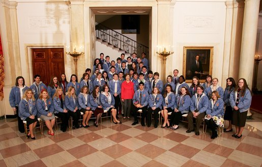 Mrs. Laura Bush poses with the winners of the Veterans of Foreign Wars (VFW) National Voice of Democracy Award on the Grand Staircase at the White House, Monday, March 5, 2007 in Washington, D.C. The young students participated in the Voice of Democracy scholarship contest, an annual audio essay competition for high school students. The contest, which is designed to foster patriotism, gives students the opportunity to voice their opinions in a three-to five-minute essay. Created in 1947, the VFW scholarship program provides $3 million in scholarships each year. White House photo by Shealah Craighead