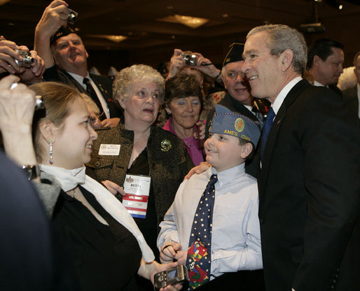 President George W. Bush poses for a photo after addressing the American Legion 47th National Convention, Tuesday, March 6, 2007, in Washington, D.C. White House photo by Eric Draper