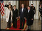 President George W. Bush and Mrs. Laura Bush welcome Jordan's King Abdullah II and Queen Rania upon their arrival to the White House for a social dinner Tuesday evening, March 6, 2007. White House photo by Paul Morse