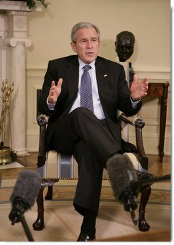 President George W. Bush speaks to members of the media during his meeting with former U.S. Sen. Bob Dole and former U.S. Health and Human Services Secretary Donna Shalala in the Oval Office, Wednesday, March 7, 2007. Dole and Shalala will co-chair the President's Commission on Care for America's Returning Wounded Warriors, a bipartisan panel that will investigate problems at the nation's military and veterans hospitals.  White House photo by Eric Draper