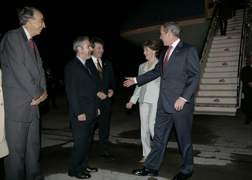President George W. Bush and Mrs. Laura Bush are welcomed on their arrival to Guarulhos International Airport by Brazil Ambassador to the U.S., Antonio de Aquiar Patriota, center, and U.S. Ambassador to Brazil, Clifford Sobel, right, in Sao Paulo, Brazil, March 8, 2007, the first stop in their week-long trip to Latin America. White House photo by Eric Draper