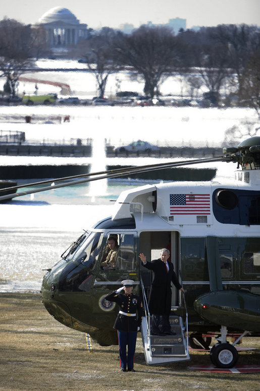 President George W. Bush waves from the steps of Marine One on the South Lawn of the White House, Thursday, March 8, 2007, as he departs for a six-day trip to Latin America. White House photo by David Bohrer