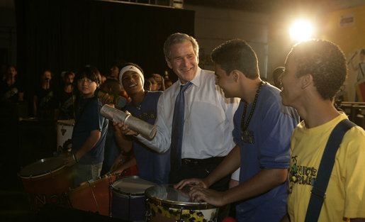 President George W. Bush joins the festivities Friday, March 9, 2007, as he plays percussion with a group of musicians after a community roundtable at Meninos do Morumbi in Sao Paulo. White House photo by Eric Draper
