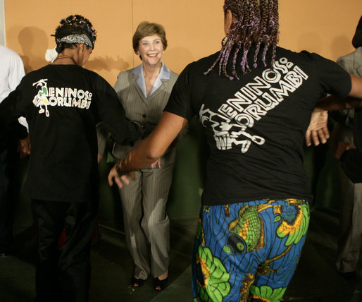 Mrs. Laura Bush laughs as she joins performers Friday, March 9, 2007, during a visit to Meninos do Morumbi, a Sao Paulo center that offers youths alternatives to drugs and crime. White House photo by Eric Draper