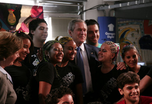 With Mrs. Laura Bush looking on, President George W. Bush poses for a photo Friday, March 9, 2007, with students at Meninos do Morumbi, a center for young people in Sao Paulo that teaches musical skills as an alternative to drugs and crime. White House photo by Paul Morse