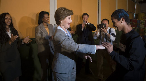 Mrs. Laura Bush is led by a student during a dance performance Friday, March 9, 2007, at Sao Paulo's Meninos do Morumbi. The stop at the center capped a daylong visit to the Brazilian city and marked the end of the first leg or a five-country, Latin American tour. White House photo by Paul Morse