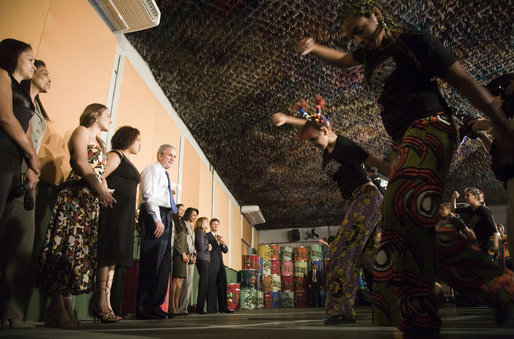 President George W. Bush looks on during a performance Friday, March 9, 2007, at Meninos do Morumbi in Sao Paulo. The President and Mrs. Laura Bush visited the center that offers youth alternatives to drugs and crime during their one-day visit to the Brazilian city. White House photo by Paul Morse
