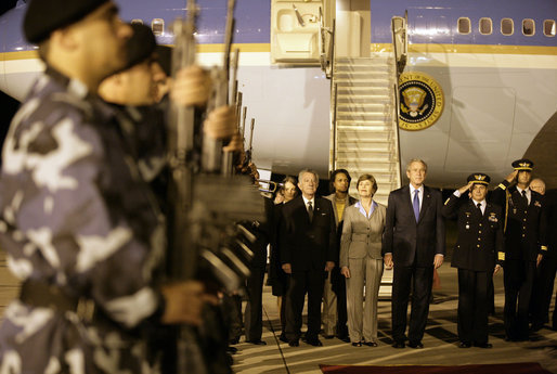 President George W. Bush and Mrs. Laura Bush arrive Friday, March 9, 2007, at Carrasco International Airport in Montevideo, Uruguay, where they are scheduled to spend two days before continuing their six-day Latin American visit. White House photo by Eric Draper