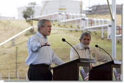 "President George W. Bush and President Lula of Brazil discuss biofuel technology during a joint press conference at Petrobras Transporte S.A. Facility Friday, March 9, 2007, in Sao Paulo, Brazil. ""And so I'm very much in favor of promoting the technologies that will enable ethanol and biodiesel to remain competitive, and therefore, affordable to the people in our respective countries and around our neighborhoods,"" said President Bush.  White House photo by Paul Morse"